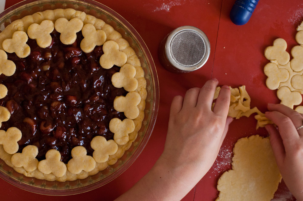 Cherry pie in the making, the top crust is being assembled.