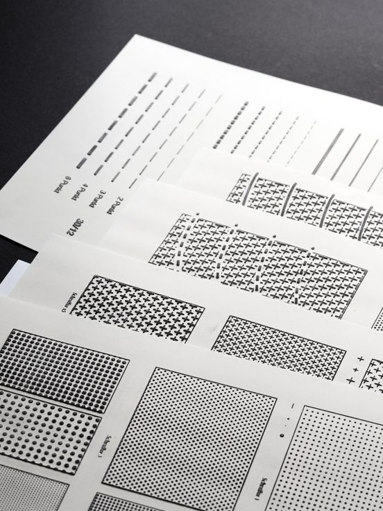 Pages of swell paper with different surface patters consisting of dots, lines and crosses