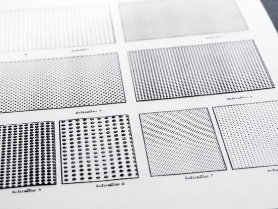 A page of swell paper with different dot pattern surfaces